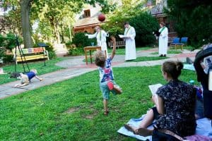 5pm worship in courtyard, with children playing